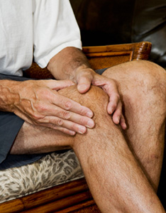 Image of man massaging arthritis pain
