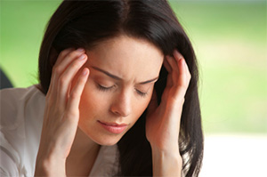 Image of a woman with a headache.