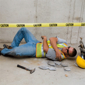 Image of a man lying on the ground after an injury on the job.